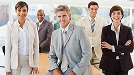 Happy businesspeople standing